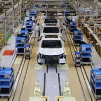 The production line at Honda Motor's new joint venture plant with Dongfeng Motor Group in Wuhan, Hubei province, last April. | REUTERS