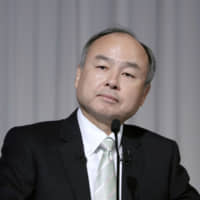 SoftBank chief welcomes activist investor Singer as Vision Fund logs loss