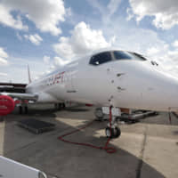 A SpaceJet regional jet, manufactured by Mitsubishi Heavy Industries Ltd., on display | BLOOMBERG