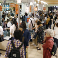 Japan household spending fell 4.8% in warm December, weighed down by tax hike