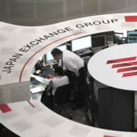 The Tokyo Stock Exchange plans to realign its current four trading markets into three in April 2022. | BLOOMBERG