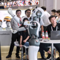 A CloudMind robot is displayed at the World Artificial Intelligence Conference in Shanghai in August last year. | BLOOMBERG