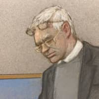 Julian Assange wearing two pair of glasses in seen at court during a hearing to decide whether he should be extradited to the United States, in London Monday in this courtroom sketch. | JULIA QUENZLER / VIA REUTERS