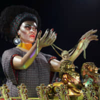 A float depicts slain rights activist Marielle Franco holding a gag during the Carnival parade at the Sambadrome in Sao Paulo on Saturday. | REUTERS