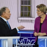Democratic candidates pile on Bloomberg over wealth, race and sexism