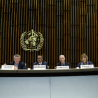 WHO chief Tedros Adhanom Ghebreyesus (third left) and other members of the WHO panel, including Marie-Paule Kieny (left) discuss the response to the COVID-19 virus outbreak, at the World Health Organization headquarters in Geneva Wednesday. | SALVATORE DI NOLFI / KEYSTONE / VIA AP