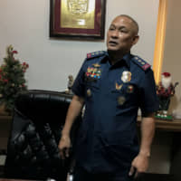 Col. Romeo Caramat, chief of the Philippine National Police Drug Enforcement Group, in his office in Manila on Dec. 11. | REUTERS
