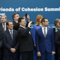 Leaders take pictures of a folk group performing during a family photo opportunity in Beja, Portugal, on Saturday, when the Friends of Cohesion group of European Union countries met to discuss the EU's multiannual financial framework. | AP