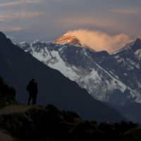 Light illuminates Mount Everest during sunset in Nepal's Solukhumbu district, also known as the Everest region, in this 2015 picture. | REUTERS