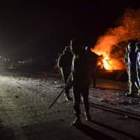 In night of violence, Greeks try to block access to island migrant camp building sites