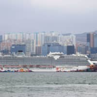 The World Dream cruise ship at the Kai Tak Cruise Terminal in Hong Kong on Wednesday | REUTERS