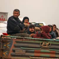 Cold and disease threaten more than half a million Syrians fleeing toward Turkey amid Idlib fighting