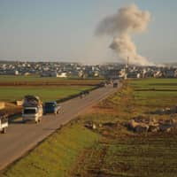 Syrians flee a bombardment by Syrian government forces in the village of Kafr Nuran in the northern province of Aleppo on Sunday.   AFP-JIJI