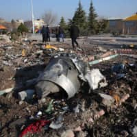Rescue teams work amid debris after a Ukrainian plane crashed near Imam Khomeini airport in Tehran early  on Jan. 8, killing all 176 people on board. The investigation into the tragedy of the Ukrainian Boeing shot down has sparked diplomatic tensions between Iran and other countries. | AFP-JIJI