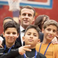 Macron unveils curbs on foreign imams and teachers amid wariness over 'separatism' risk