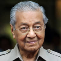 Malaysia's interim prime minister, Mahathir Mohamad, leaves an event in Kuala Lumpur on Friday. | REUTERS