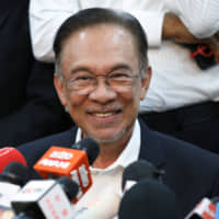 Malaysian politician Anwar Ibrahim holds a news conference in Petaling Jaya on Wednesday. | REUTERS