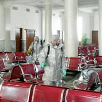 Disinfectant is sprayed at an undisclosed location in North Korea amid concerns over COVID-19. | AFP-JIJI