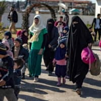 Syria's Kurds hand over 35 Islamic State-linked orphans to Russia