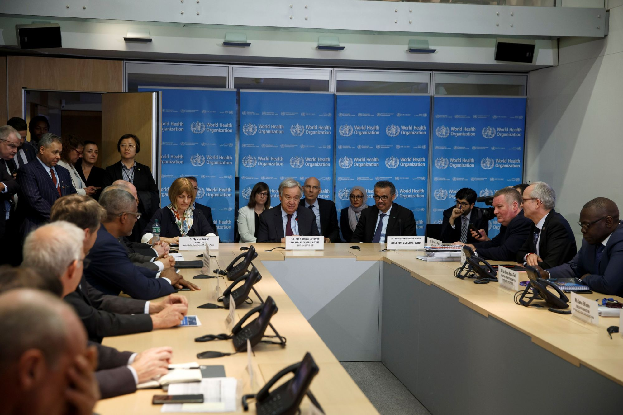 U.N. Secretary General Antonio Guterres speaks while sitting next to Director General of the World Health Organization (WHO) Tedros Adhanom Ghebreyesus during an update on the situation regarding the COVID-19  at the World Health Organization headquarters in Geneva Monday. | SALVATORE DI NOLFI / POOL / VIA REUTERS