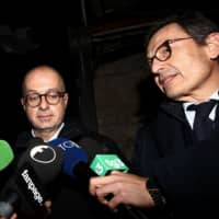 Fabio Alonzi (left) and Francesco Petrelli, lawyers of U.S. citizen Gabriel Christian Natale-Hjorth, speak to journalists outside the criminal court of Rome on Wednesday at the end of the opening day of a trial in which their client and another American stand accused of killing a police officer in Rome last year. | AFP-JIJI