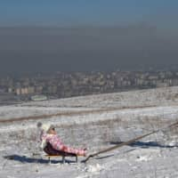 Smog veils Central Asia cities as smoky stoves choke locals