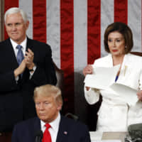 U.S. House Speaker Nancy Pelosi tears her copy of President Donald Trump's State of the Union address after he delivered it to a joint session of Congress on Tuesday. Before the address, Trump turned his back on Pelosi as she offered to shake his hand. | AP
