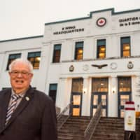 Quinte West Mayor Jim Harrison is photographed in front of the Canadian Forces Base (CFB) Trenton 8 Wing Headquarters as CFB Trenton prepare for the arrival and quarantine of Canadians evacuated from China due to the outbreak of coronavirus, in Trenton, Ontario, Tuesday. | REUTERS