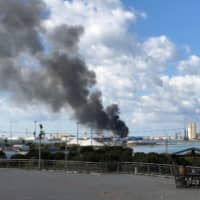 Port hit by barrage of rocket fire in Libyan capital, say witnesses