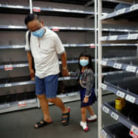 Why Singapore's admired coronavirus playbook can't be replicated