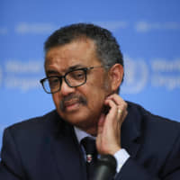 Tedros Adhanom Ghebreyesus, director-general of the World Health Organization, pauses during a news conference on COVID-19 in Geneva on Feb. 18. | BLOOMBERG