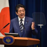 Prime Minister Shinzo Abe delivers a speech during a news conference on the new COVID-19 coronavirus at the Prime Minister's Office in Tokyo on Saturday. | AFP-JIJI