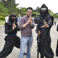 A Turkish man poses for a photo with a group of ninja at Nagoya Castle in Nagoya, Aichi Prefecture. | KYODO