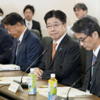 Health minister Katsunobu Kato (second from right) attends a meeting of infectious disease experts held Monday at the ministry to discuss measures to tackle the new coronavirus outbreak in Japan. | KYODO