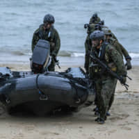 Japan and Australia look to hammer out status of forces pact in June