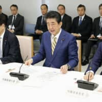 Prime Minister Shinzo Abe speaks at a government meeting held at the Prime Minister's Office on Saturday to discuss measures to tackle the new coronavirus outbreak. | KYODO