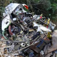 Remains of a crashed rescue helicopter are scattered in the mountains in Gunma Prefecture in August 2018. | JAPAN TRANSPORT SAFETY BOARD / VIA KYODO