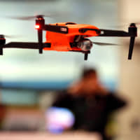The Metropolitan Police Department has put up posters at airports and train stations in English and Japanese saying that drones may not be flown without permission almost anywhere in Tokyo in principle. | REUTERS