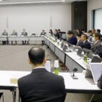 A panel of experts with the health ministry Wednesday discusses approval of a gene therapy for treating spinal muscular atrophy. | KYODO