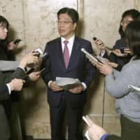 Health minister Katsunobu Kato speaks to reporters at the Diet building Wednesday. | KYODO