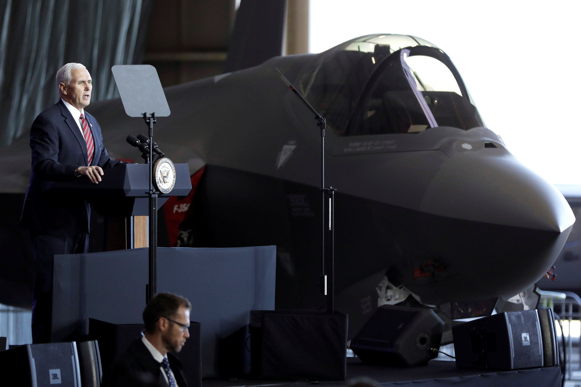 U.S. Vice President Mike Pence speaks to members of the U.S. military and the Self-Defense Forces in front of a U.S. Air Force F-35 fighter at Yokota Airbase in Fussa, Tokyo, in February 2018. | REUTERS