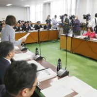 Hokkaido Prefectural Assembly education committee members meet Wednesday to discuss closing schools in hope of preventing further spread of the new virus. | KYODO