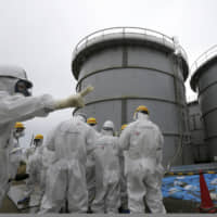 A government panel has said that releasing radioactive water accumulating at the Fukushima No. 1 nuclear power plant into the ocean is the most reliable option. | AP