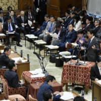 Prime Minister Shinzo Abe speaks at the Lower House Budget Committee on Monday. | KYODO
