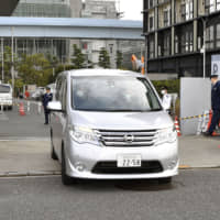 A Tokyo police vehicle carrying singer Noriyuki Makihara, who has been arrested for alleged drug possession, leaves the Metropolitan Police Department's Wangan Police Station in the Odaiba waterfront district in Koto Ward on Friday . | KYODO