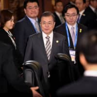 South Korea's President Moon Jae-in attends a trilateral leaders' meeting between China, South Korea and Japan in Chengdu, China, in December. | REUTERS