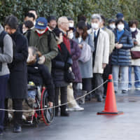 People line up in the city of Yokohama on Monday for tickets to the trial of a man charged with murdering 19 residents in 2016 in a knife rampage at a care home. | KYODO