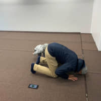 Indonesian faithful Topan Rizki Utraden prays inside the Mobile Mosque at a parking lot in Tokyo.   REUTERS