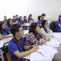 Young people in Myanmar study Japanese in October to apply for Japan's new skilled-worker visas. | KYODO