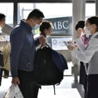 Passengers in the departure lobby proceed to board a Shanghai-bound flight Feb. 1. at Kansai International Airport in Osaka Prefecture. | KYODO